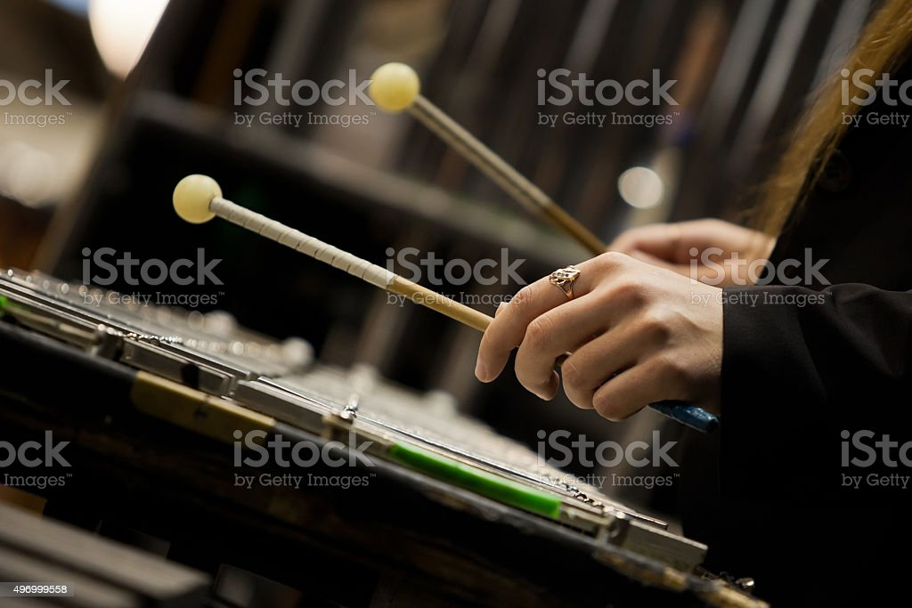 Hands girl playing a glockenspiel stock photo