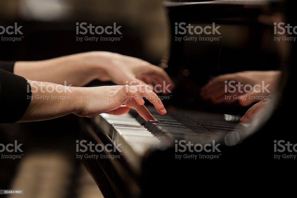 Hands girl playing piano stock photo