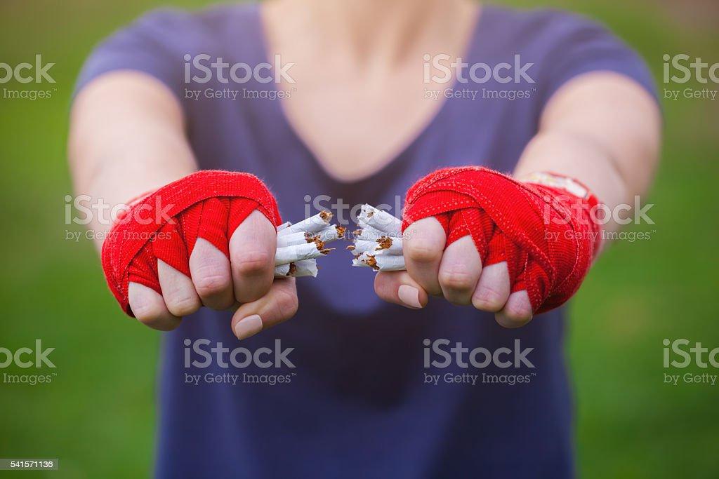 Hands girls wrist wraps cigarette break . stock photo