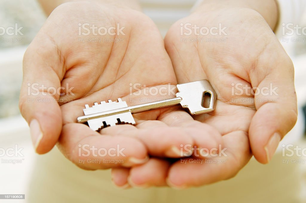 Hands giving a key royalty-free stock photo