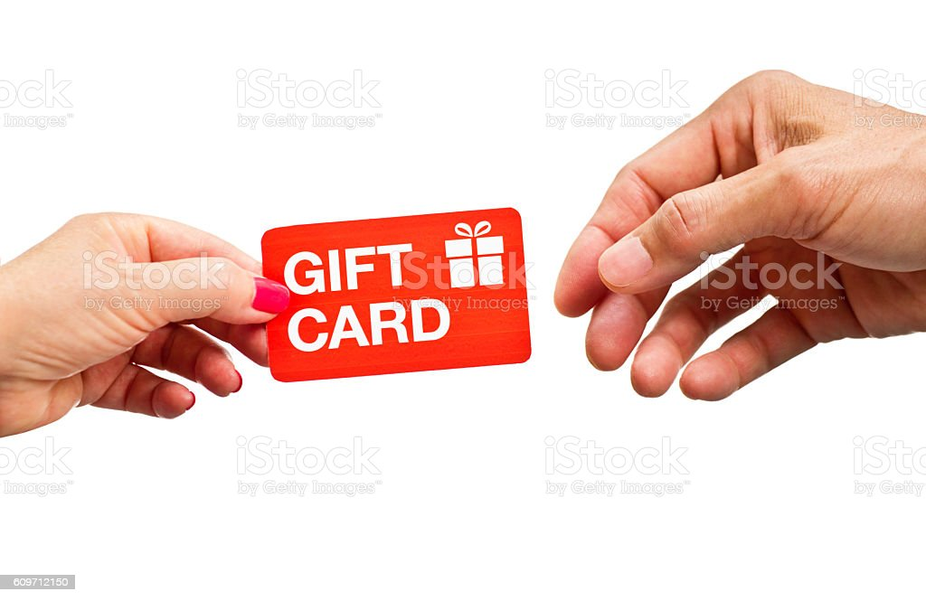 Hands Giving and Receiving Retail Gift Card on White Background stock photo