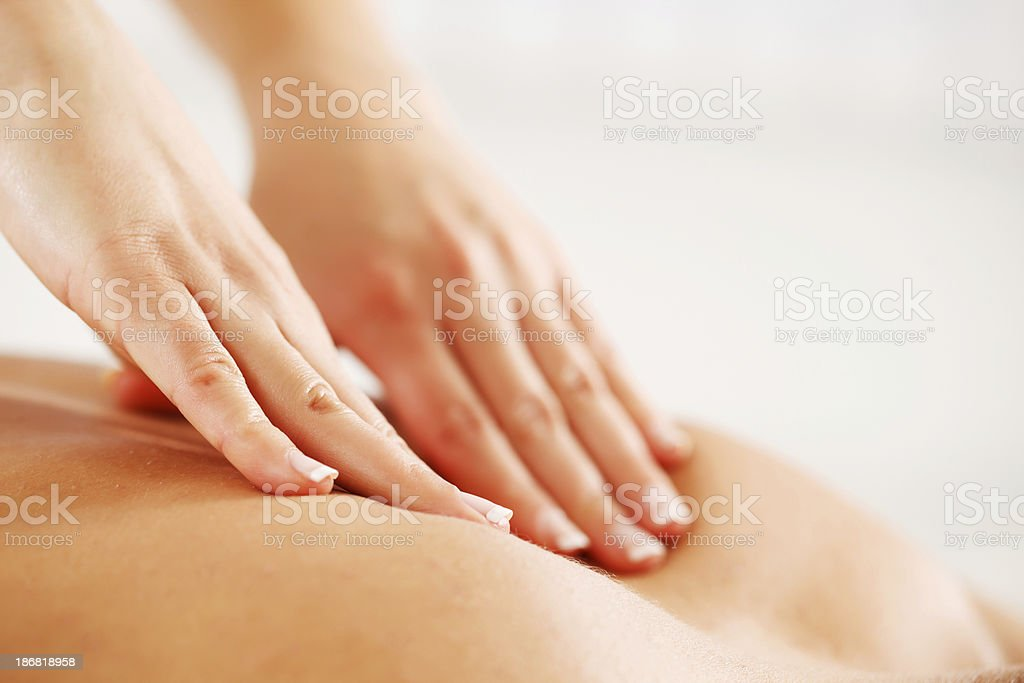 Hands giving back massage stock photo