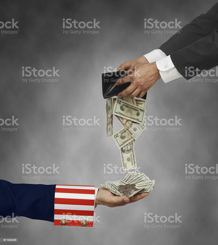 Hands giving money to a patriotic hand to show Tax Day stock photo