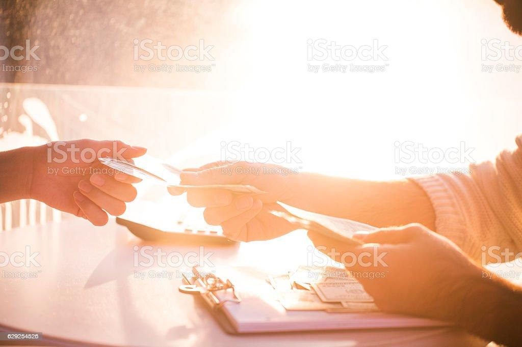 Hands giving & receiving money stock photo