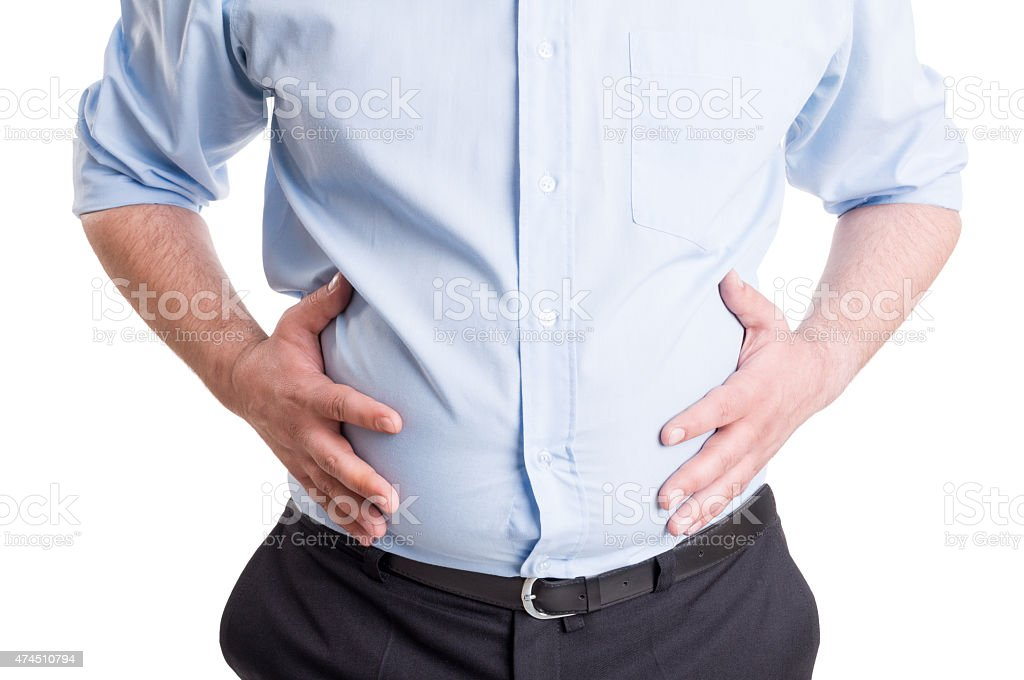 Hands grabbing bloated abdomen stock photo