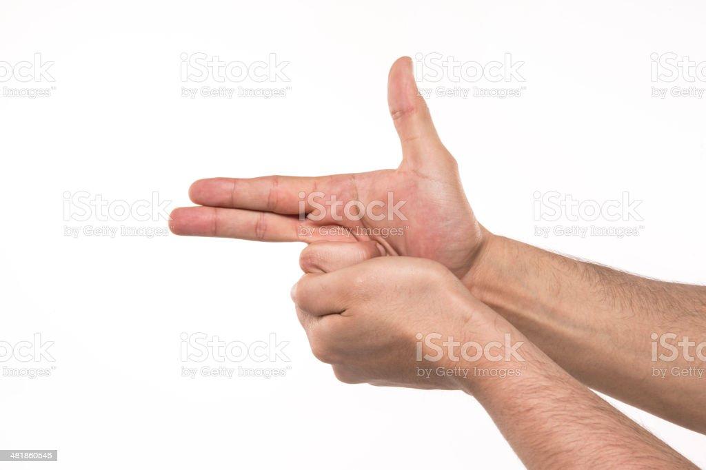Hands Gun Sign stock photo