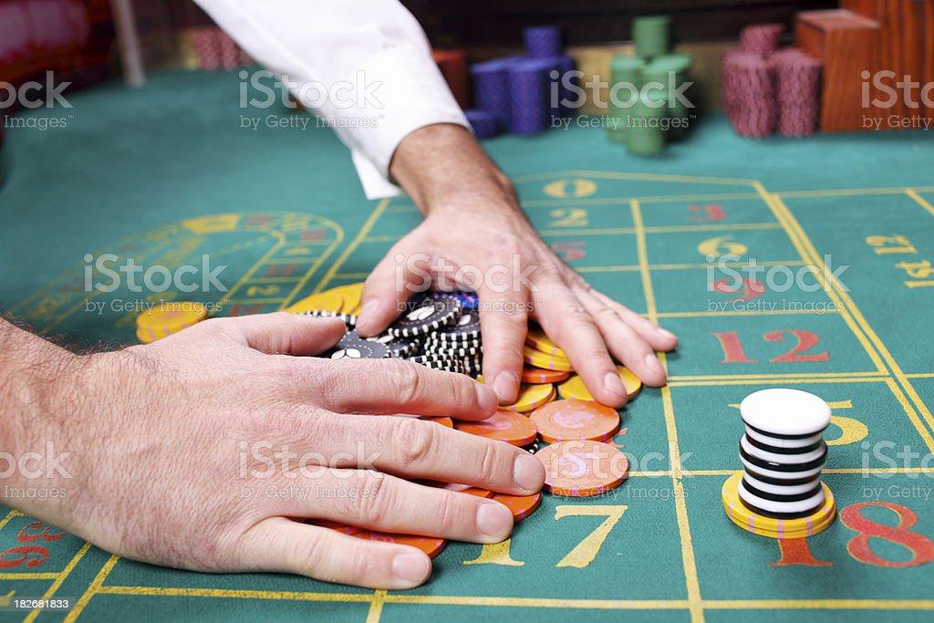 Hands handling a big pile of gambling. stock photo