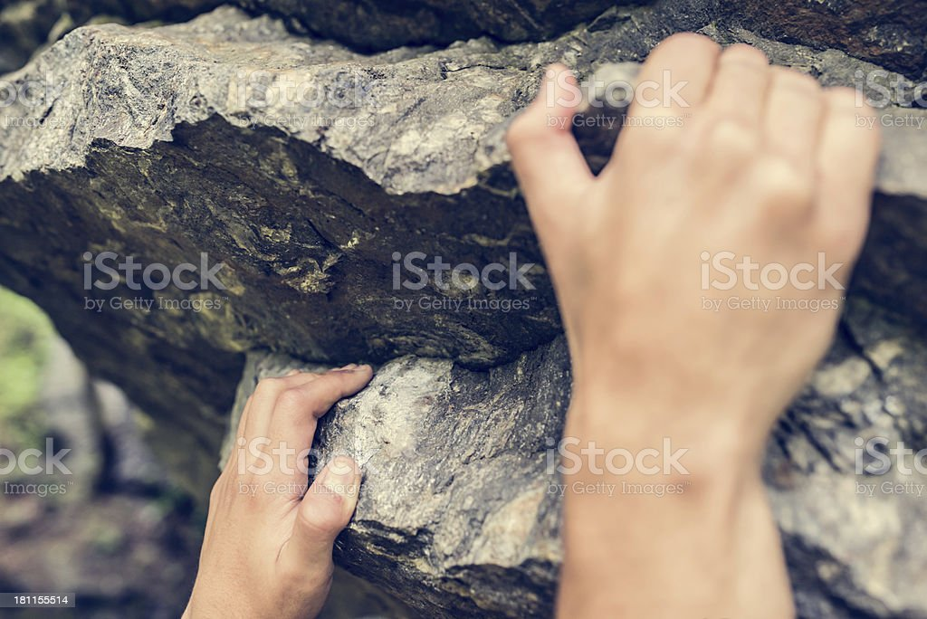 Hands Hang on Boulder royalty-free stock photo