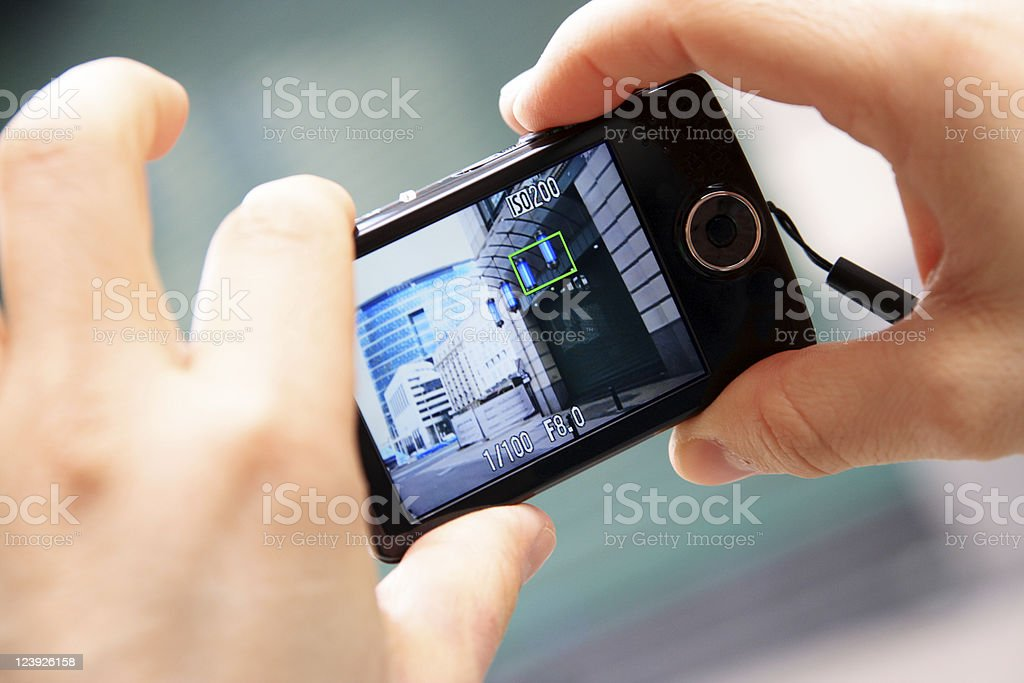 Hands Hold a Compact Digital Camera, Photographing stock photo