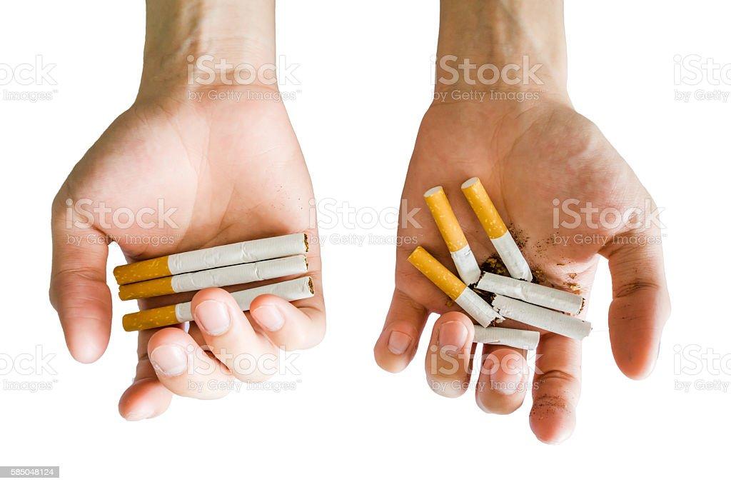 Hands hold cigarette alternative full or break on white background stock photo