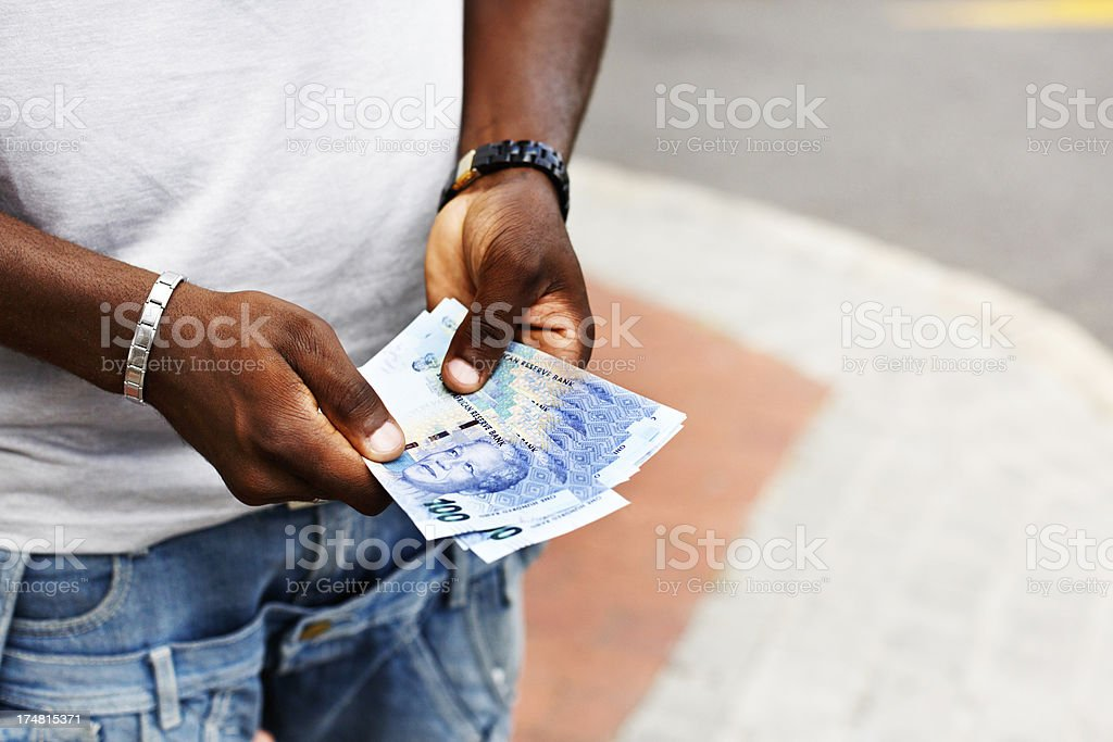 Hands hold new South African banknotes featuring Nelson Nandela royalty-free stock photo