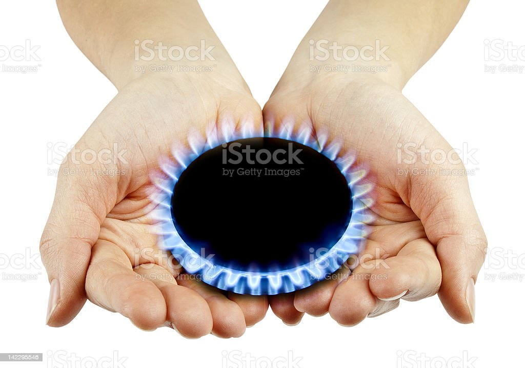 Hands holding a black disc surrounded by small blue flames royalty-free stock photo