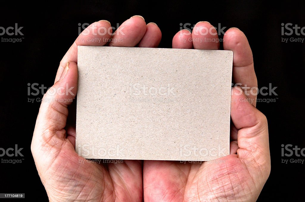 Hands holding a blank card royalty-free stock photo