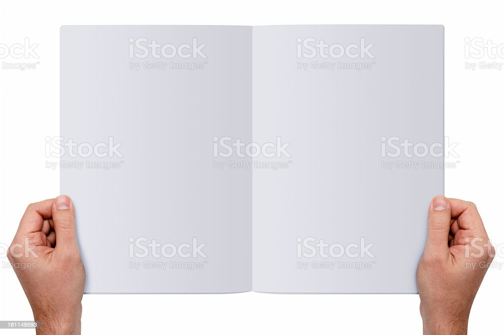 Hands holding a blank magazine royalty-free stock photo
