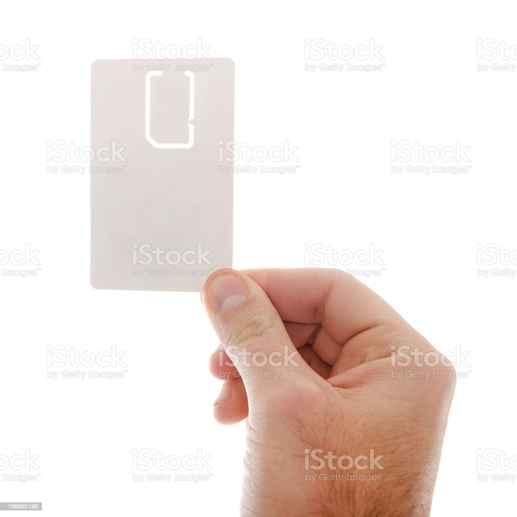 hands holding a blank new sim card on white background stock photo
