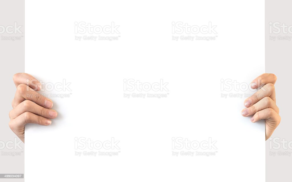 Hands holding a blank white board stock photo