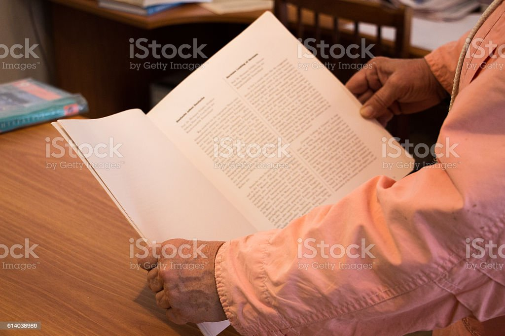 Hands holding a book stock photo