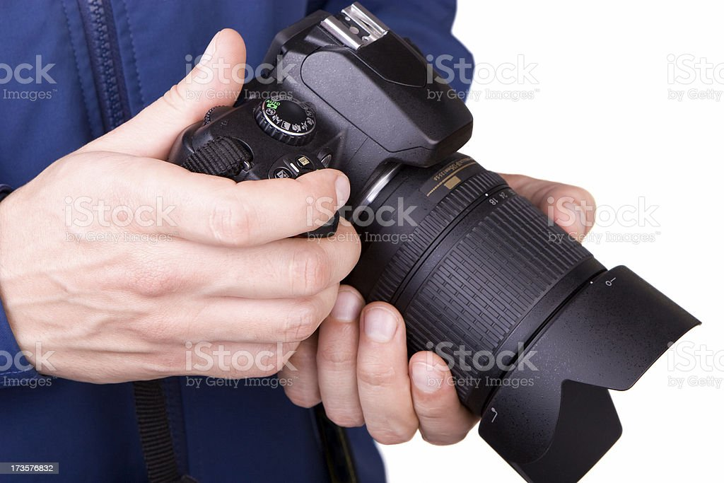 Hands holding a camera royalty-free stock photo