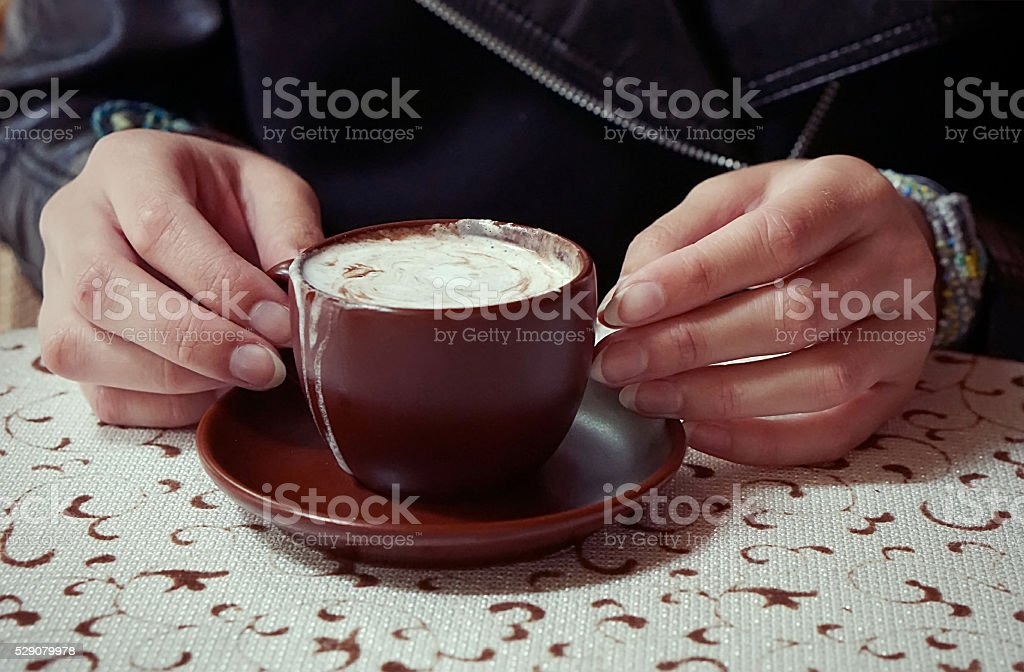 Hands holding a cup of caffe mocha stock photo