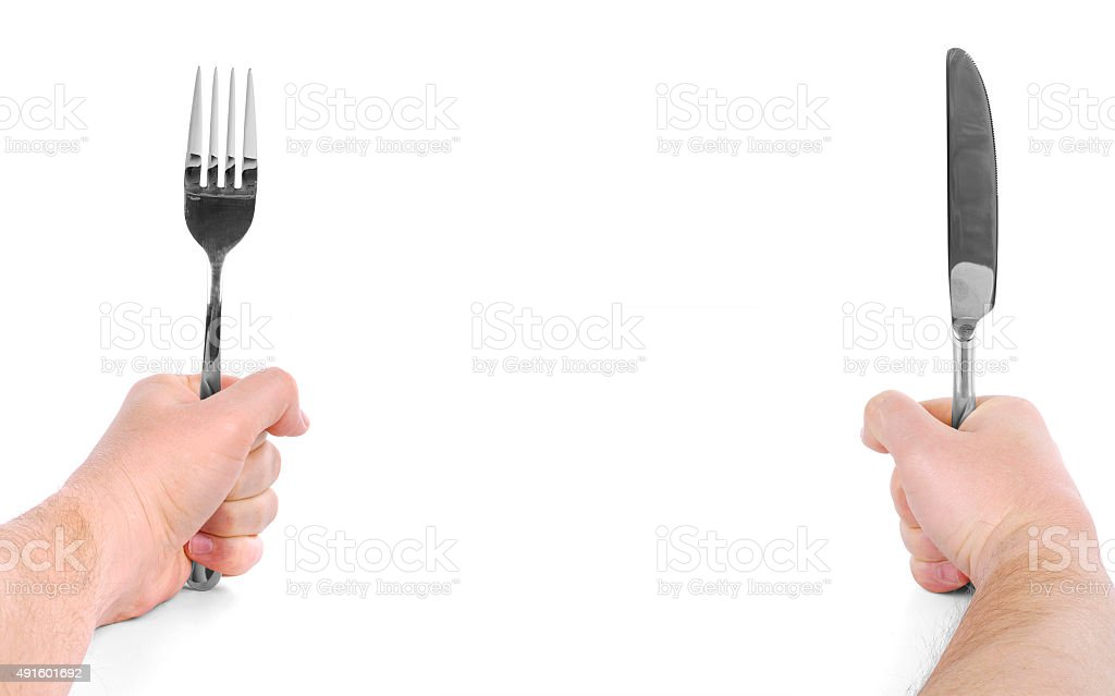 Hands holding a fork and a knife stock photo