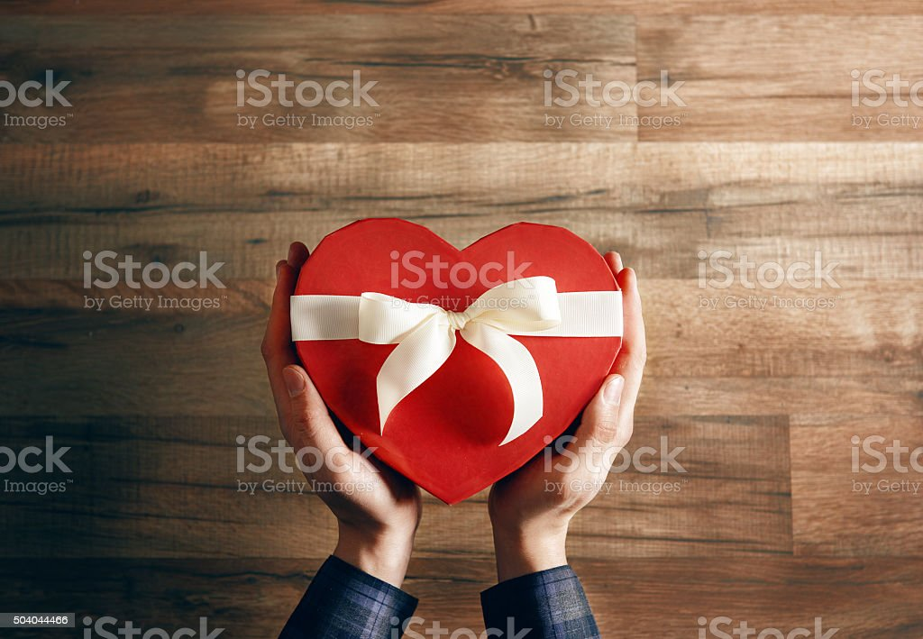 hands holding a gift stock photo