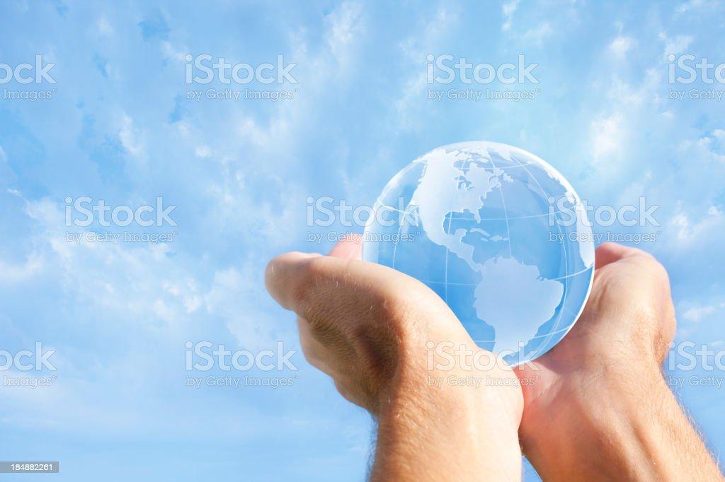 Hands Holding a Globe Towards Sky royalty-free stock photo