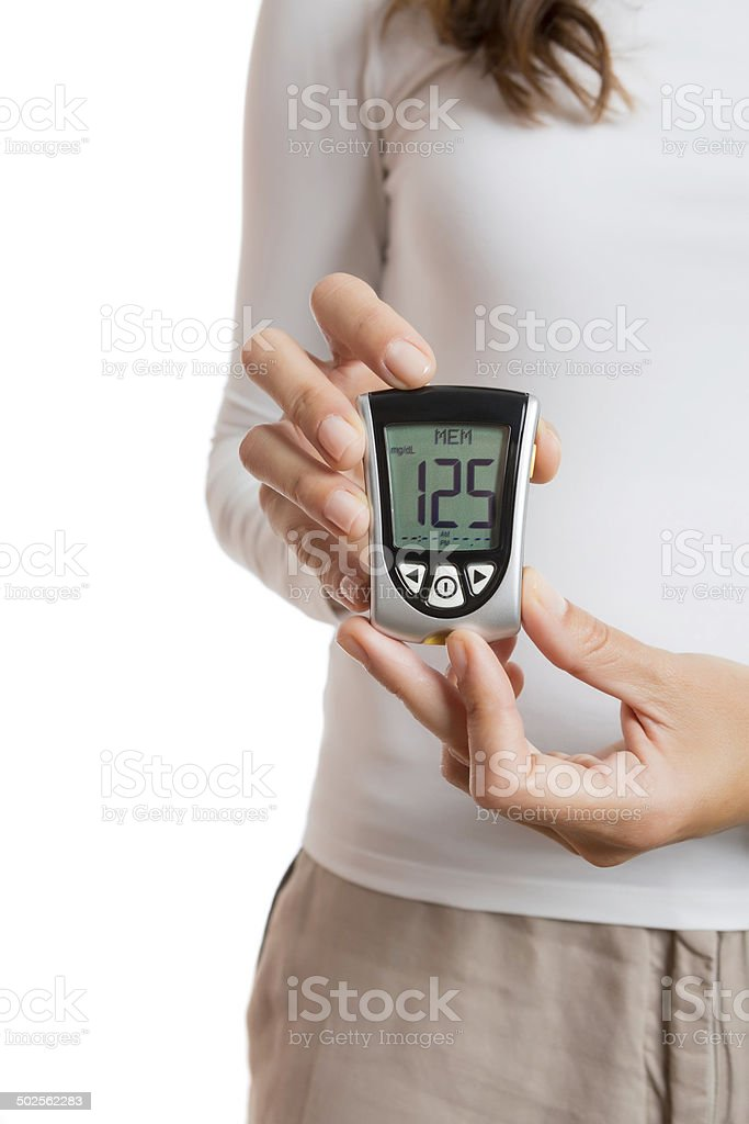 hands holding a glucometer royalty-free stock photo