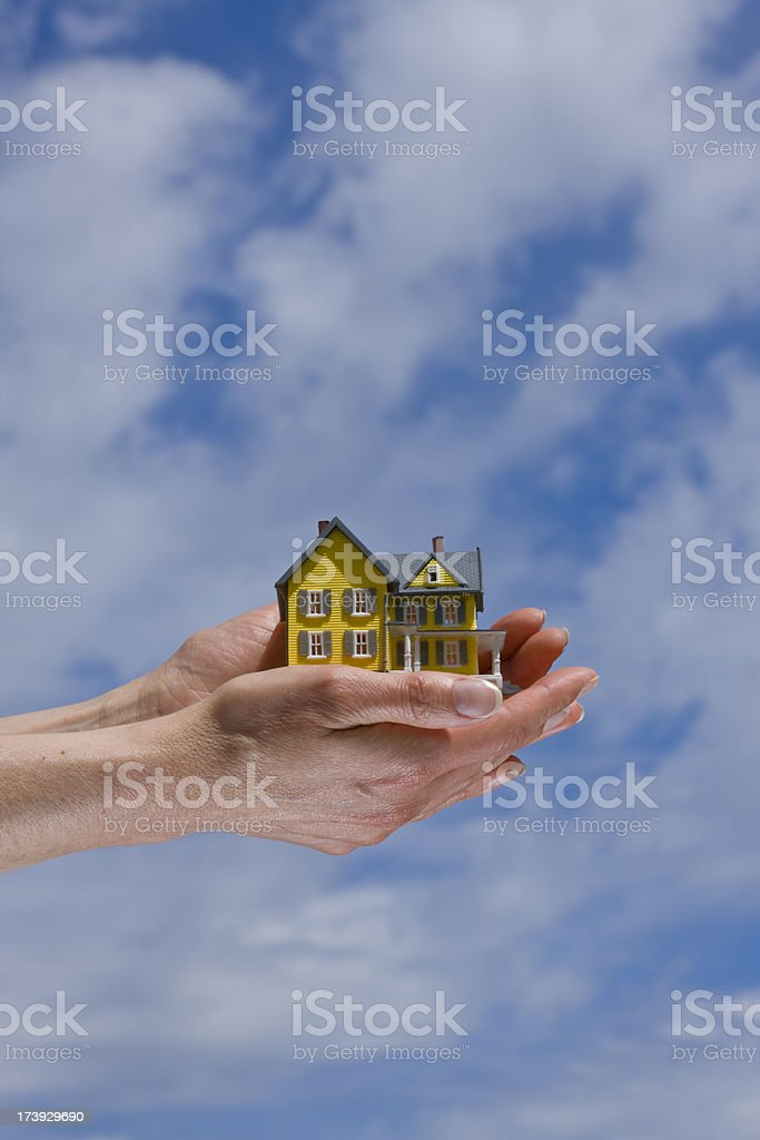 Hands Holding a House. stock photo