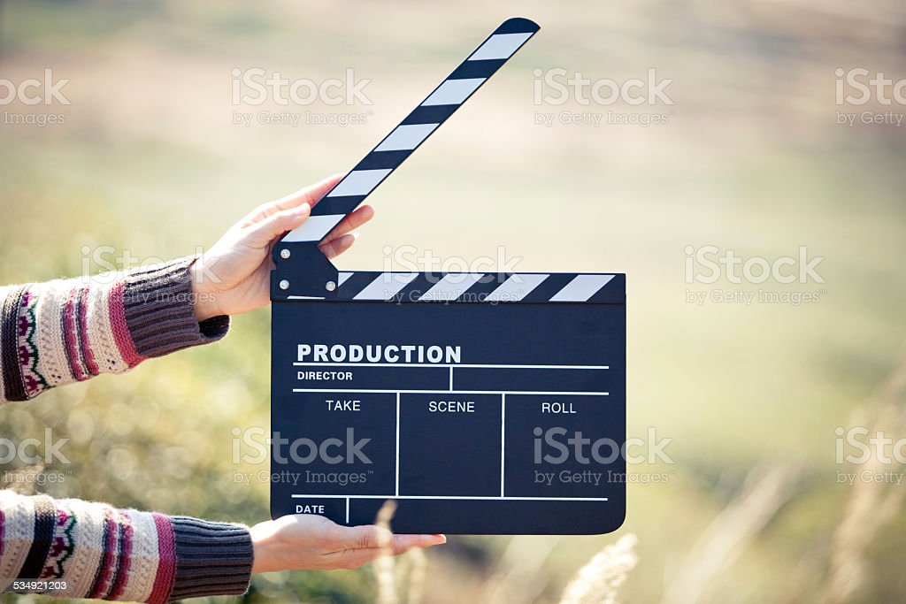 Hands holding a movie clapboard stock photo