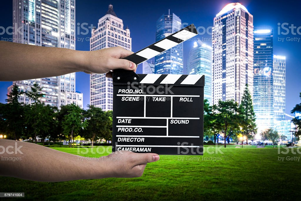 Hands Holding a Movie Clapperboard stock photo