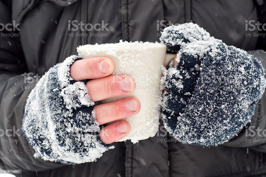 Hands holding a mug stock photo
