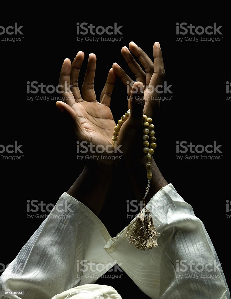 hands holding a muslim rosary stock photo