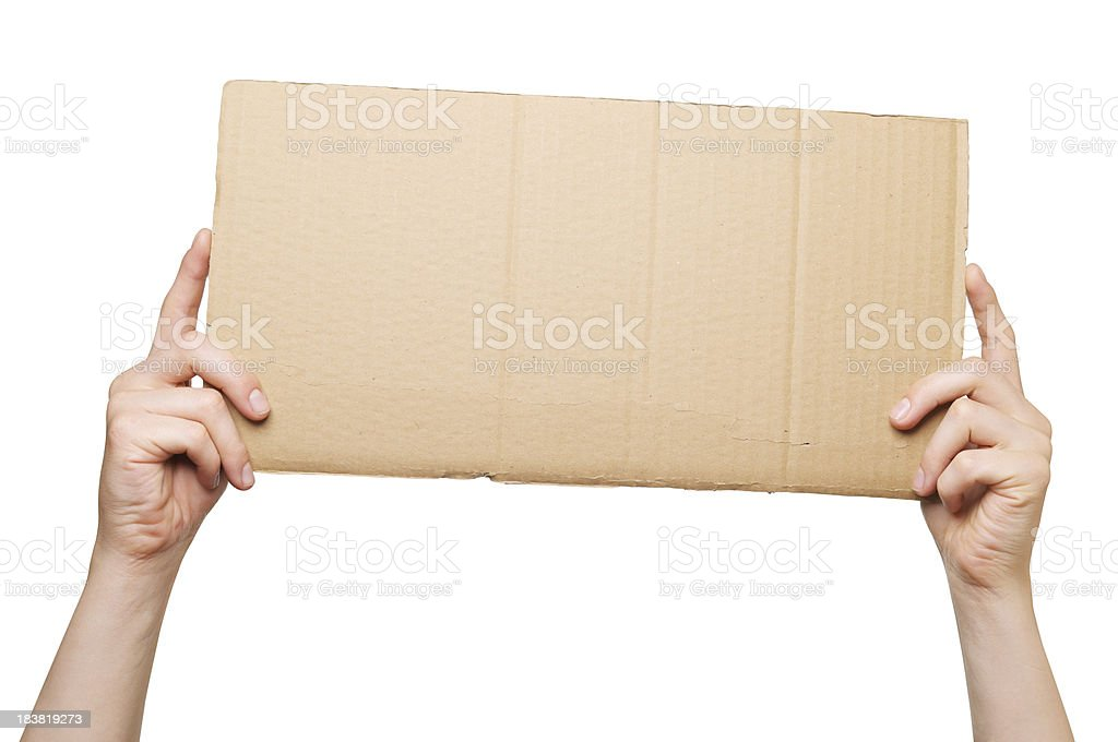 Hands holding a piece of cardboard royalty-free stock photo