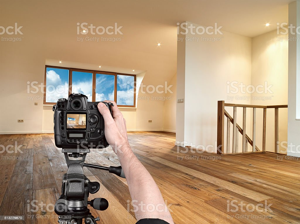 Hands holding a professional camera on tripod stock photo