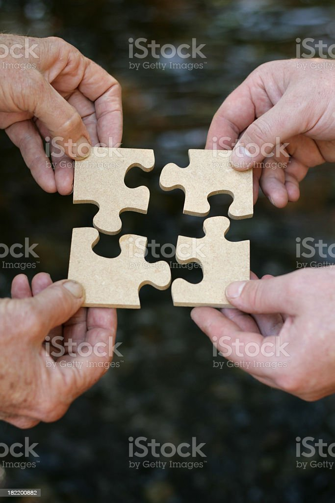 Hands holding a puzzle royalty-free stock photo