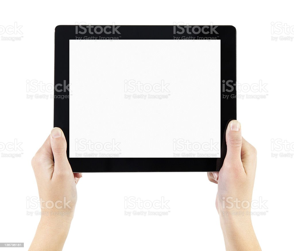 Hands holding a tablet of with a blank screen royalty-free stock photo