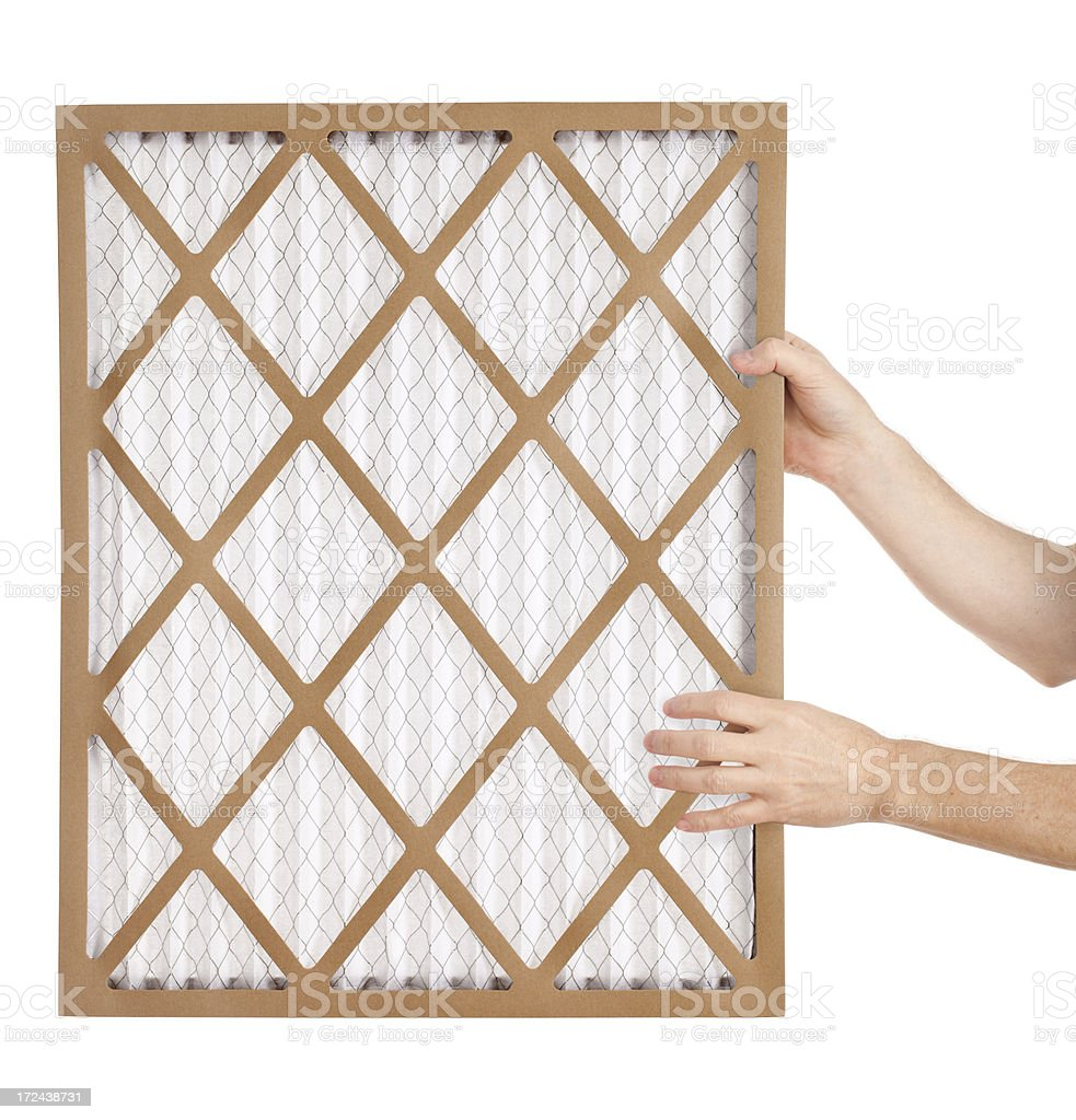 Hands Holding an Air Filter royalty-free stock photo