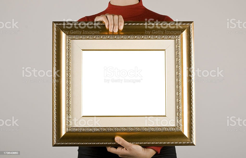 Hands holding an empty golden frame stock photo