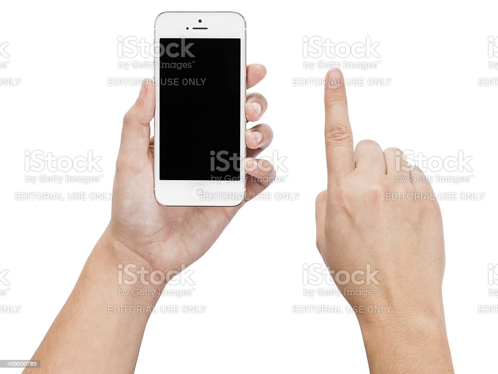 Hands Holding an iPhone 5 (Isolated on White) stock photo