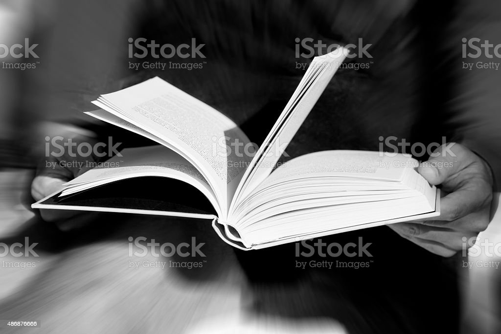 Hands holding an open book stock photo