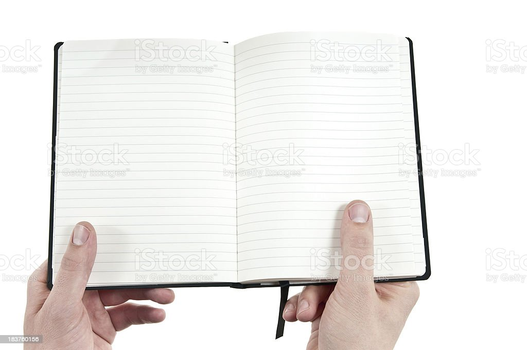 hands holding an open workbook to take notes royalty-free stock photo