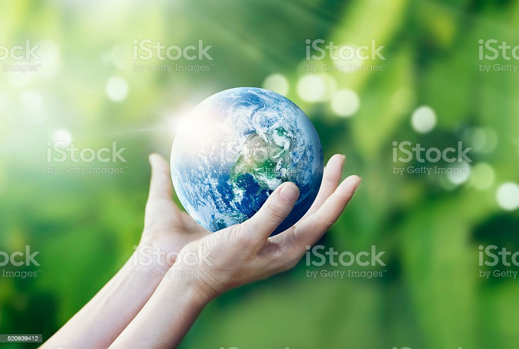 Hands holding and protect earth on nature background stock photo
