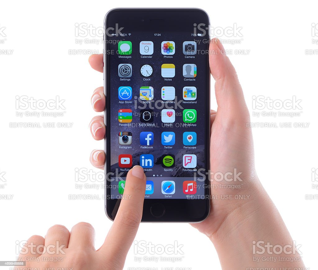 Hands holding and touching Apple iPhone 6 plus stock photo