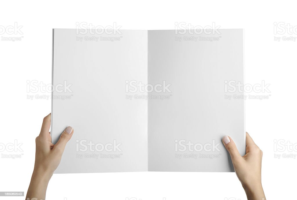 Hands holding blank magazine page royalty-free stock photo