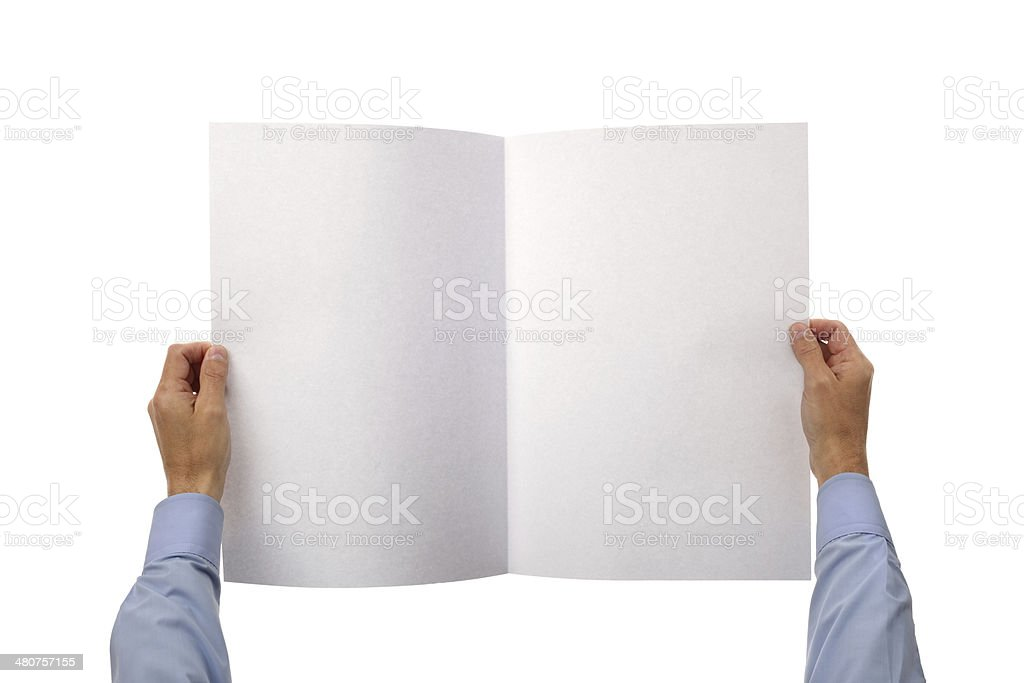Hands holding blank newspaper stock photo