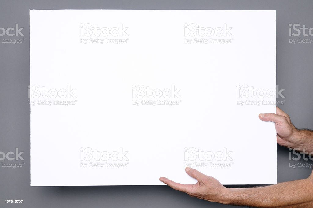 Hands Holding Blank Paper Sign.CopySpace stock photo