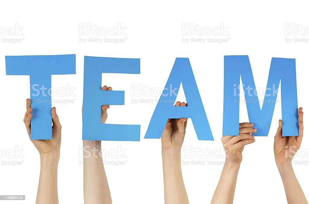 hands holding blue letters building team royalty-free stock photo