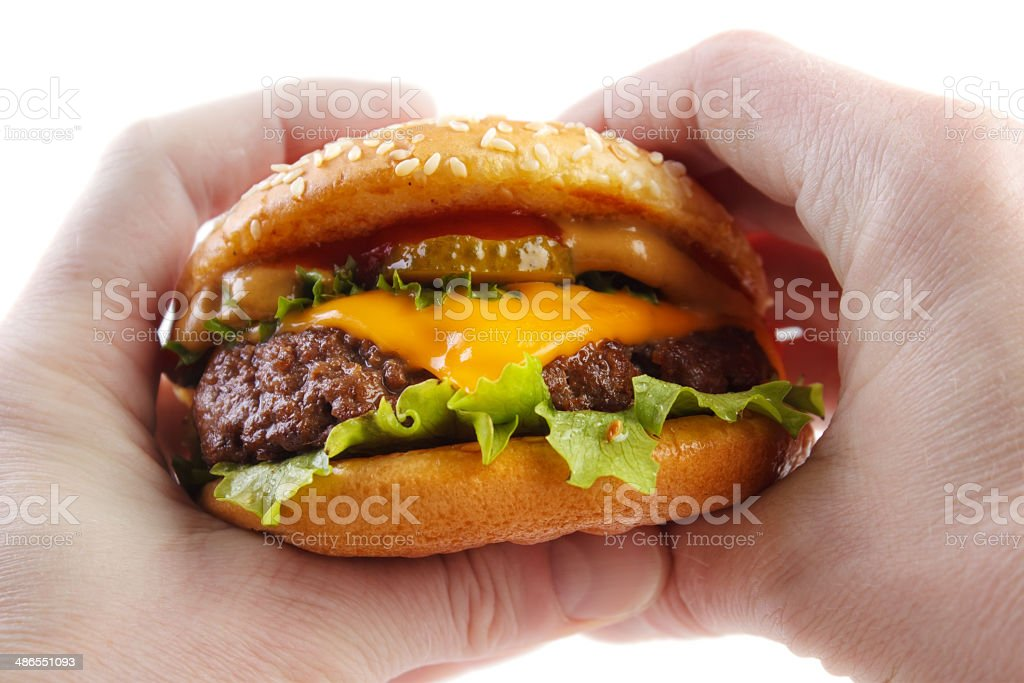 Hands holding burger royalty-free stock photo