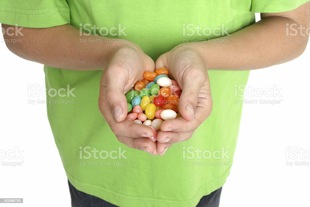 Hands holding candy stock photo