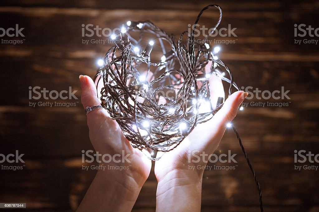 Hands holding christmas garland stock photo